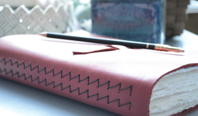 Red leather artist journal