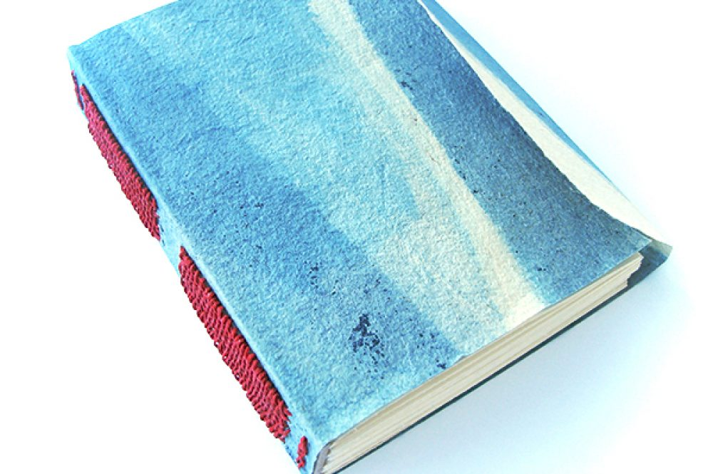 Long stitch / Link stitch binding with indigo cave paper