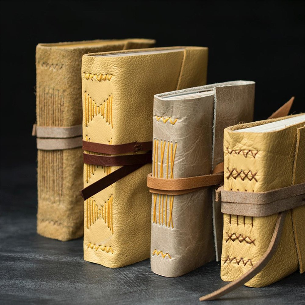 leather books Quill & Arrow