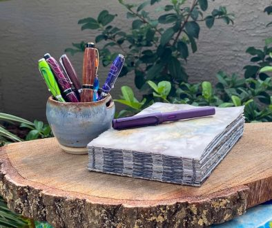art journals on table with pens