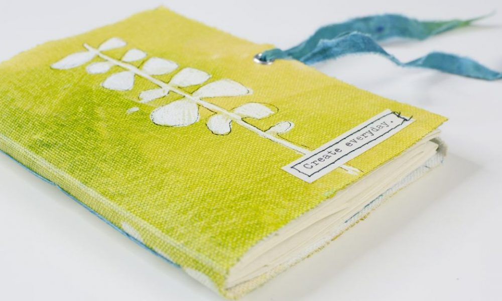 green and yellow pamphlet stitch book