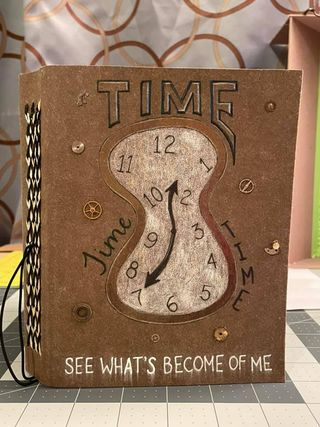 brown book cover with drawing of abstract clock